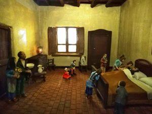 L'immagine è una ricostruzione della vita di Santa Maria Goretti e rappresenta la morte di suo padre. La fotografia è stata scattata all'interno del santuario di Nettuno